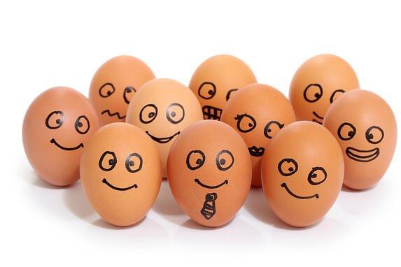 Eggs with smiley faces drawn on to represent focus groups as a research method